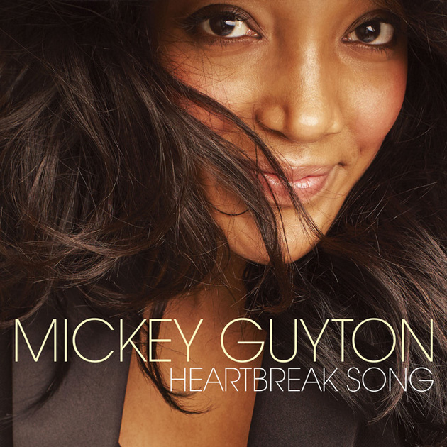 "MICKEY GUYTON RELEASES NEW SINGLE ""HEARTBREAK SONG"" TO COUNTRY RADIO"